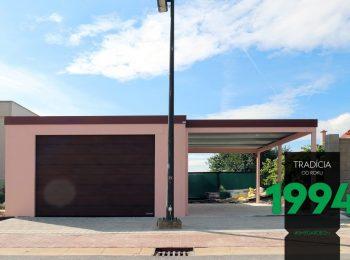 Eine GARDEON Garage mit Carport an der rechten Seite in der Farbe Rosa