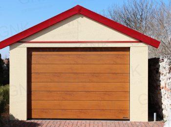 Eine montierte Garage in licht-gelb mit einem roten Satteldach