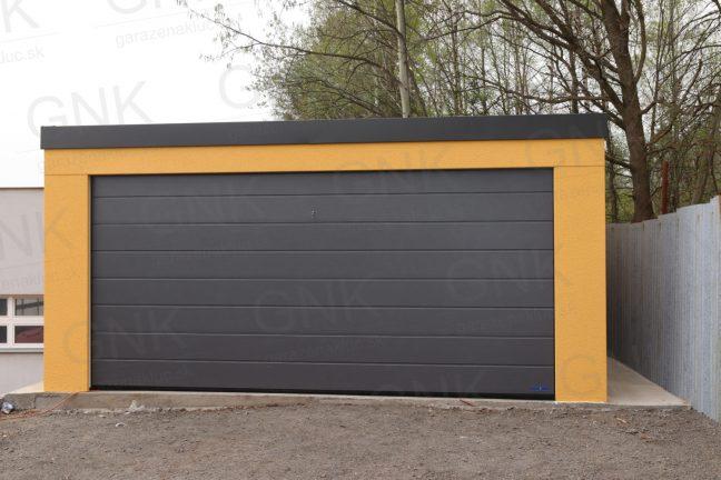 Eine gelbe Doppelgarage mit einem Flachdach in anthrazit