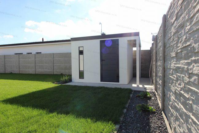 Ein Gartenhäuschen mit Pultdach und einer Überdachung für Holz