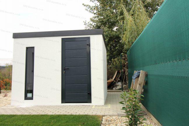 Ein montiertes Gartenhaus mit Flachdach in anthrazit und Neigung nach hinten