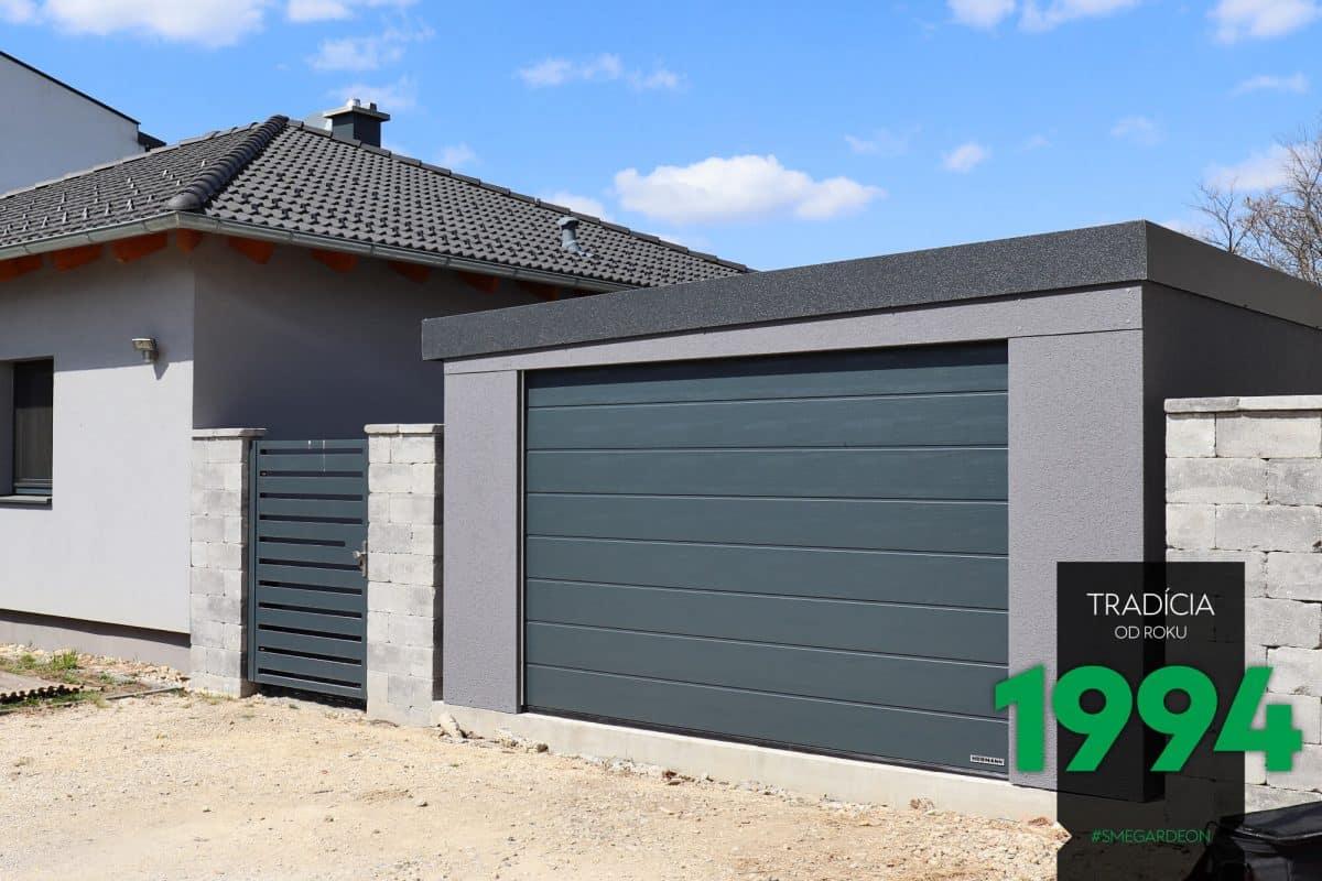 Eine simple, graue Garage mit Pultdach
