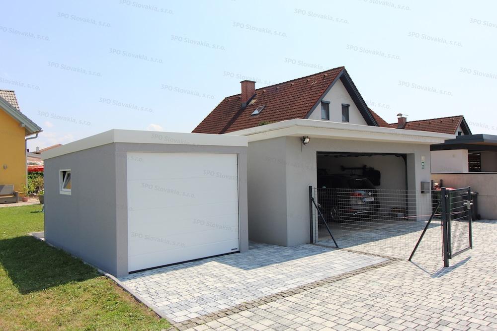 Eine montierte GARDEON Garagen neben einer gemauerten Garage