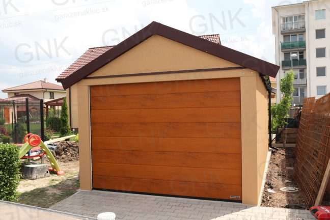 Eine Einzelgarage mit Satteldach in der Farbe braun