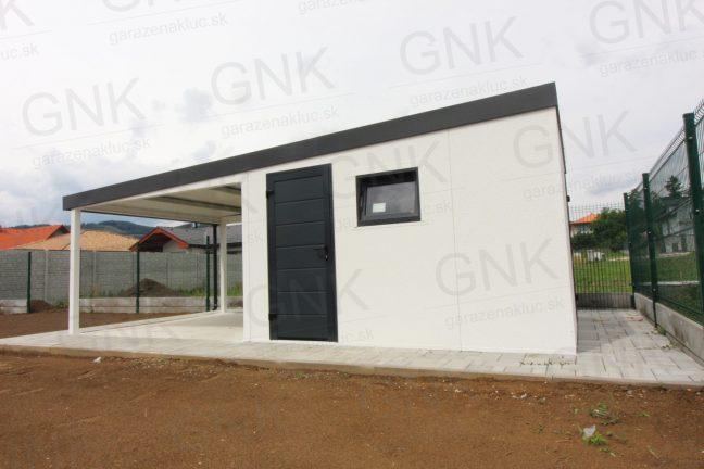 Ein modernes Gartenhaus mit einem weißen Putz und einer gedämmten Tür in anthrazit