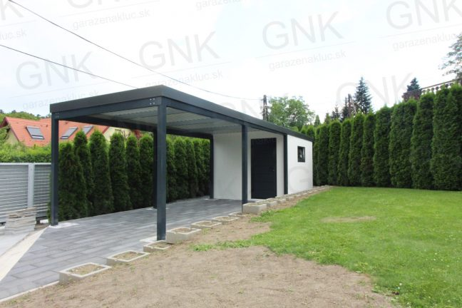 Ein modernes Gartenhaus mit einem Carport in anthrazit