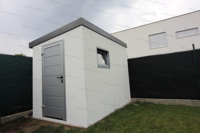 Ein Gartenhäuschen mit einer isolierten Tür von Hörmann in der Farbe weißes Aluminium