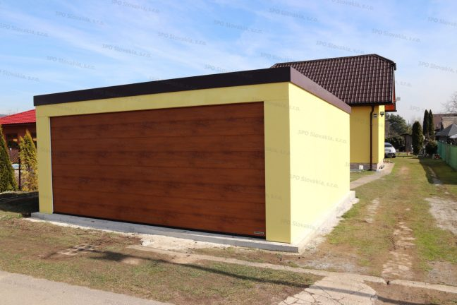 Eine gelbe Doppelgarage von GARDEON beim Familienhaus