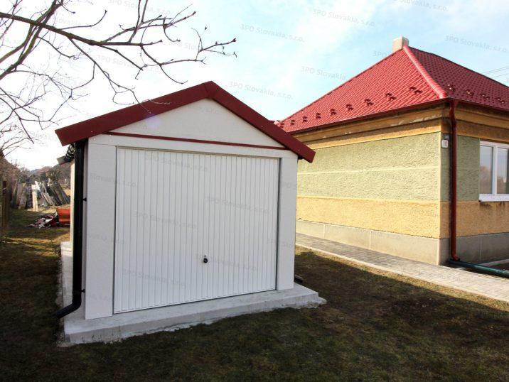 Eine montierte Garage von GARDEON mit einem roten Satteldach