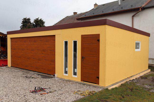 Eine Maßangefertigte Garage in gelb mit braunem Tor
