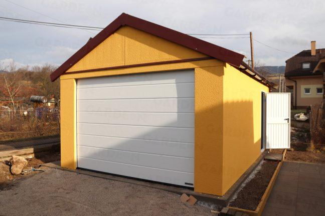 Eine Satteldach-Garage in dunkel-gelb