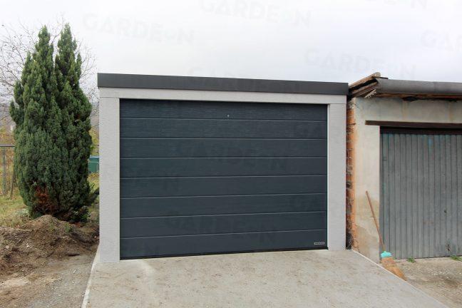 Eine Garage in grauem Verputz