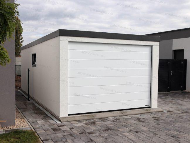 Eine 1-Auto-Garage mit weißem Putz und der Attika in anthrazit