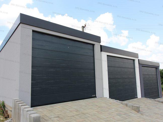 Drei alleinstehende Garagen in den Farben licht-grau, weiß und dunkel-grau
