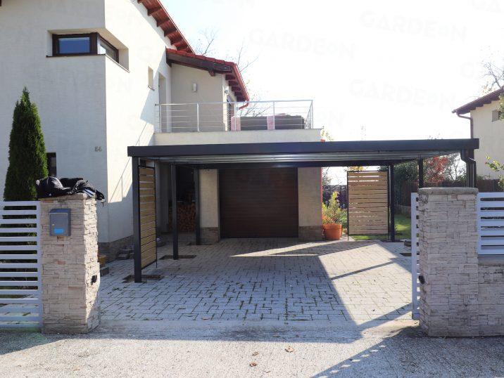 Ein GARDEON Carport in anthrazit an einem Haus