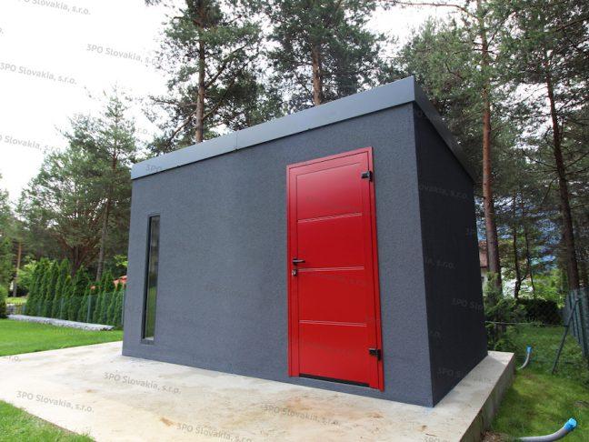 Ein montiertes Gartenhaus in dunkel-grau mit einer roten LPU40 Tür von Hörmann