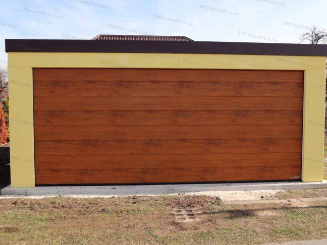 Eine montierte Garage von GARDEON in licht-gelb mit dem TOR in der Farbe goldene-Eiche