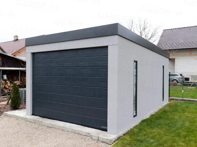 Eine Garage in grau mit Flachdach