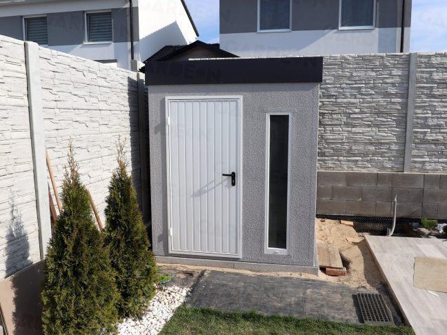 Ein Gartenhäuschen von GARDEON mit einer weißen Tür
