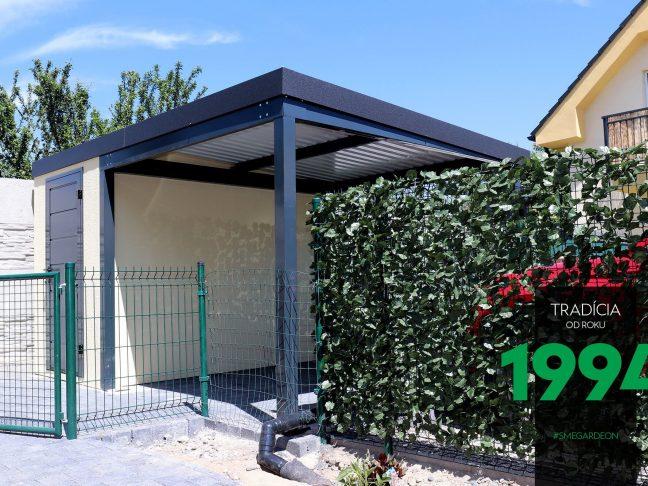 Ein kleines Gartenhaus mit einer Überdachung in anthrazit